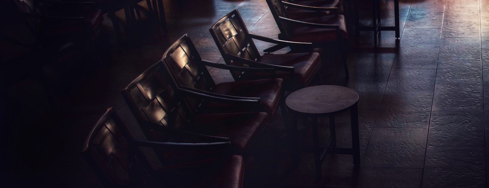 A set of chairs placed in the Theater area for a screening inside The Ramble Hotel.