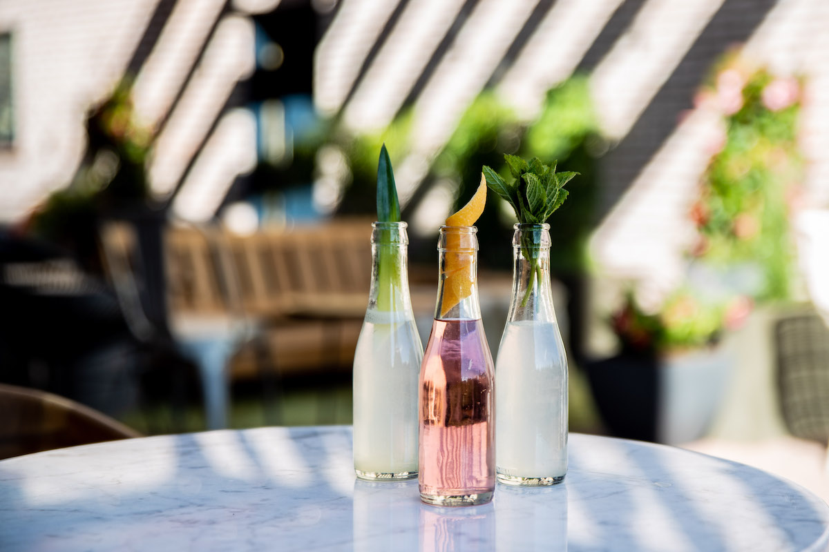 Fun summer drinks on a table in an outdoor patio environment.